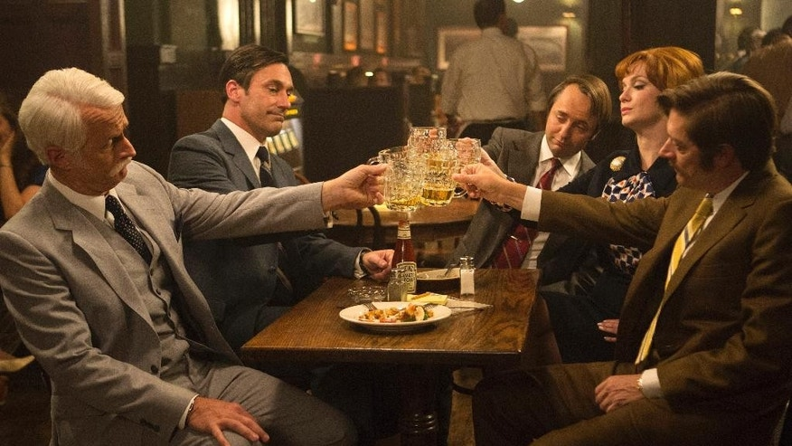 """This image released by AMC shows, from left, John Slattery as Roger Sterling, Jon Hamm as Don Draper, Vincent Kartheiser as Pete Campbell, Christina Hendricks as Joan Harris and Kevin Rahm as Ted Chaough, in a scene from the final season of """"Mad Men."""" The series finale airs on Sunday.  (Justina Mintz/AMC via AP)"""