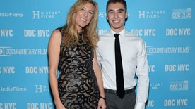 """FILE - In this Nov. 14, 2014 file photo, director Amy Berg poses with Evan Henzi from the film, at the world premiere of """"An Open Secret"""" during DOC NYC at the SVA Theater, New York. Documentary 'An Open Secret' by Amy Berg, screens at the 68th international Cannes film festival."""