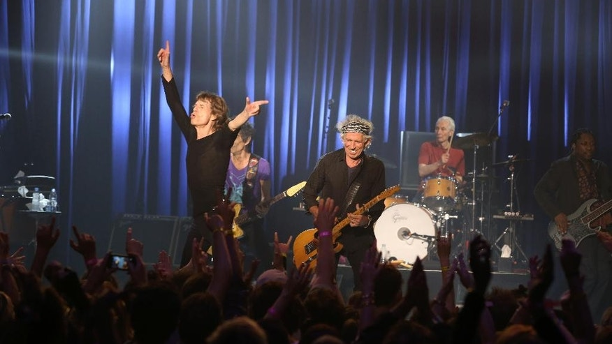 "Mick Jagger and the Rolling Stones perform at the Fonda Theatre in Los Angeles, Wednesday, May 20, 2015. The Rolling Stones ripped through the intimate Fonda Theatre Wednesday with enough energy to fuel their entire 15-city North American tour. The band announced Wednesday morning it would perform a ""club show"" that night to kick off its Zip Code tour, which launches Sunday in San Diego. The surprise concert at the 1,300-person-capacity venue instantly sold out. (Jane Bouquet/The Rolling Stones via AP)"