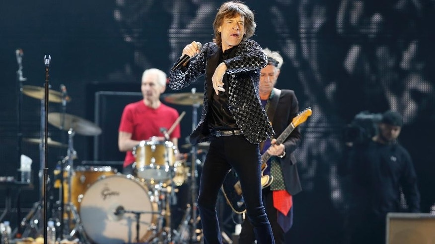 "FILE - This Feb. 26, 2014 file photo shows Mick Jagger and the Rolling Stones performing during their concert at Tokyo Dome in Tokyo. The Stones are performing a surprise concert at the Fonda Theatre in Los Angeles on Wednesday, May 20, 2015. Their 2015 North American ""Zip Code"" tour kicks-off at Petco Park in San Diego on Sunday, May 24. (AP Photo/Shizuo Kambayashi, File)"