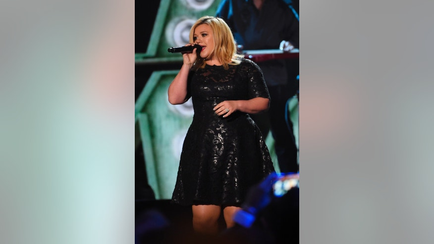 December 15, 2014. Kelly Clarkson singing at the American Country Countdown Awards in Nashville, Tennessee.