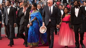 From left, Marc Zinga, Vincent Rottiers, Kalieaswari Srinivasan, director Jacques Audiard, Claudine Vinasithamby and Jesuthasan Antonythasan arrive for the screening of the film Dheepan at the 68th international film festival, Cannes, southern France, Thursday, May 21, 2015. (Photo by Arthur Mola/Invision/AP)