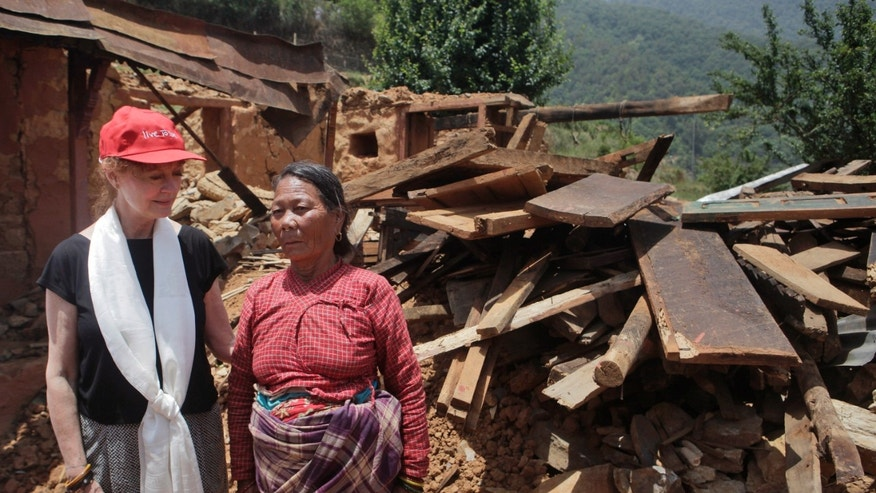 May 24, 2015. Oscar-winning Hollywood actress Susan Sarandon, left, comforts Saailee Tamang, who lost her home in the April 25 earthquake, at Ramkot village on the outskirts of Kathmandu, Nepal.