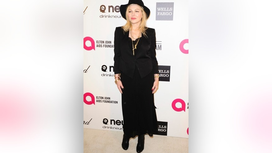 Tatum O'Neal arrives at the 2014 Elton John AIDS Foundation Oscar Party in West Hollywood, California March 2, 2014.