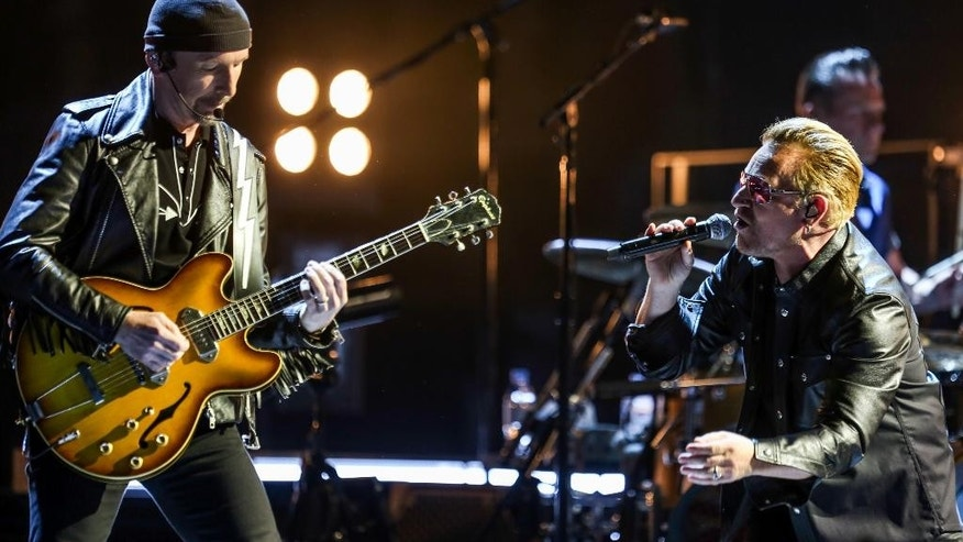 The Edge, left, and Bono of U2 perform at the Innocence + Experience Tour at The Forum on Tuesday, May 26, 2015, in Inglewood, Calif. (Photo by Rich Fury/Invision/AP)