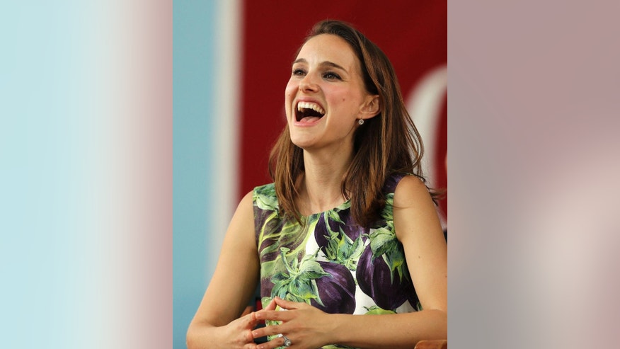 Actress Natalie Portman laughs during Harvard College's Class Day, Wednesday, May 27, 2015, on the campus of Harvard University, in Cambridge, Mass. Portman, a 2003 Harvard graduate, is scheduled as the 2015 Class Day speaker for Harvard College. (AP Photo/Steven Senne)