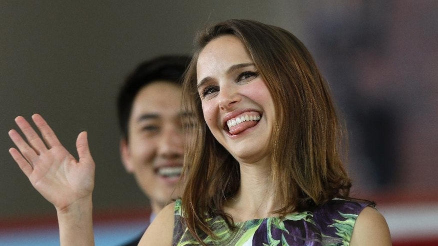 Actress Natalie Portman waves as she takes the stage at Harvard College's Class Day, Wednesday, May 27, 2015, on the campus of Harvard University, in Cambridge, Mass. Portman, a 2003 Harvard graduate, is scheduled as the 2015 Class Day speaker for Harvard College. (AP Photo/Steven Senne)