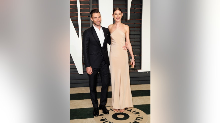 February 22, 2015. Musician Adam Levine and wife, model Behati Prinsloo, arrive at the 2015 Vanity Fair Oscar Party in Beverly Hills, California.