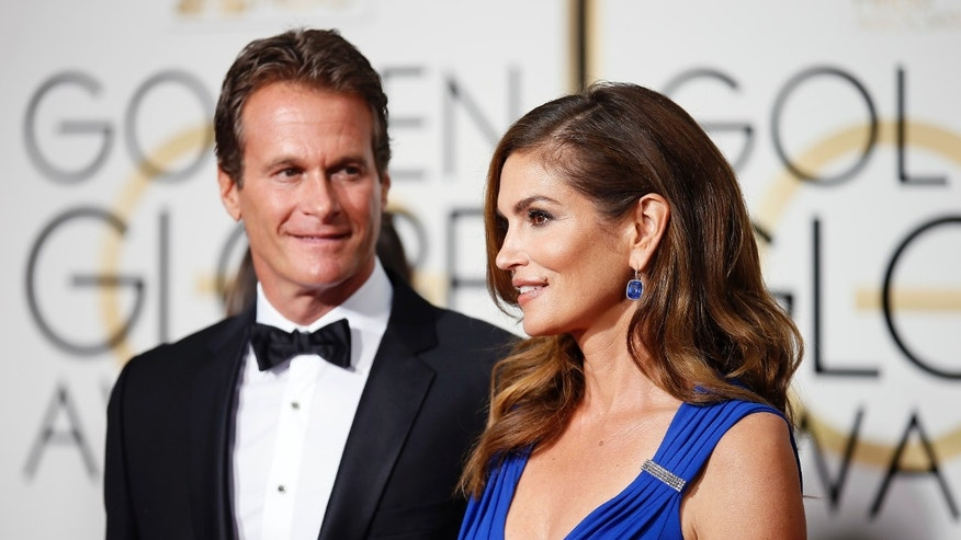 January 11, 2015. Rande Gerber and Cindy Crawford arrive at the 72nd Golden Globe Awards in Beverly Hills, California.