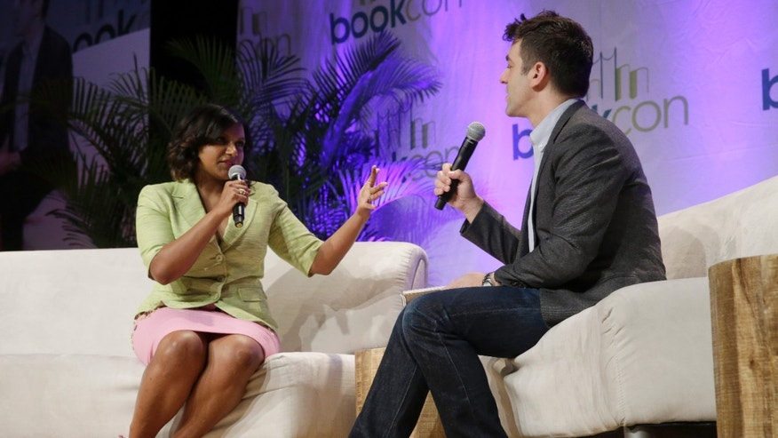 May 30, 2015. Actress Mindy Kaling, left, talks to actor BJ Novak during a panel discussion at BookCon at the Jacob K. Javits convention center in New York.