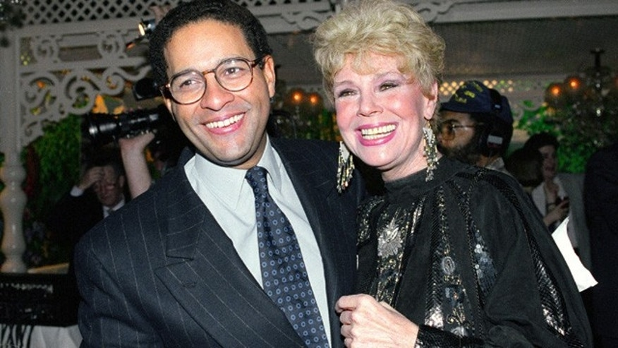 FILE - In this Jan. 13, 1992 file photo, NBC's'Today' show co-anchor Bryant Gumbel, left, and former member of the morning television show Betsy Palmer pose at the 40th anniversary party for the show in New York City. Palmer, the actress whose long film, stage and television career began in 1951 in the early days of live television and who later found a new generation of fans in her role as Mrs. Vorhees in the cult film classic Friday the 13th, has died at the age of 88.(AP Photo/Mark Lennihan, File)
