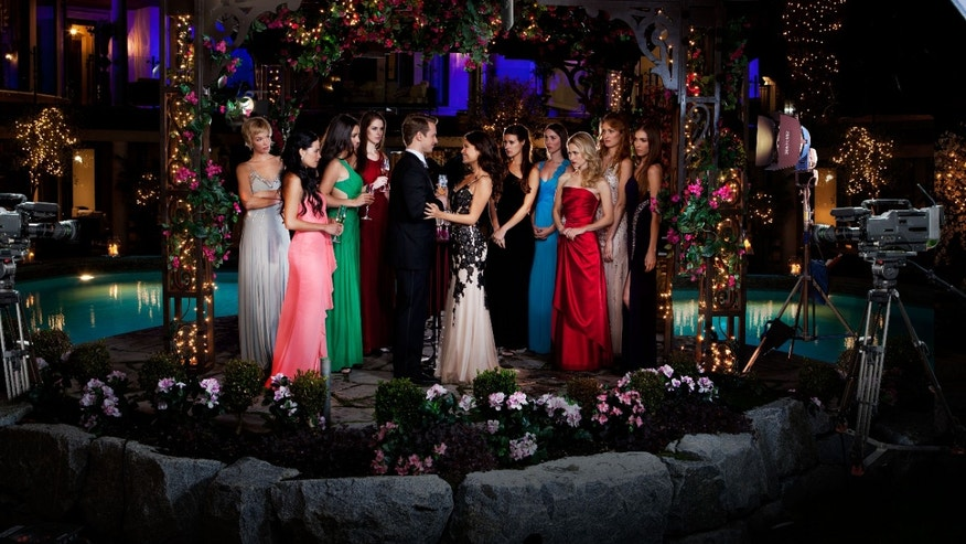 "The cast of ""UnREAL"" poses in a scene from the series, airing on Lifetime on Mondays."