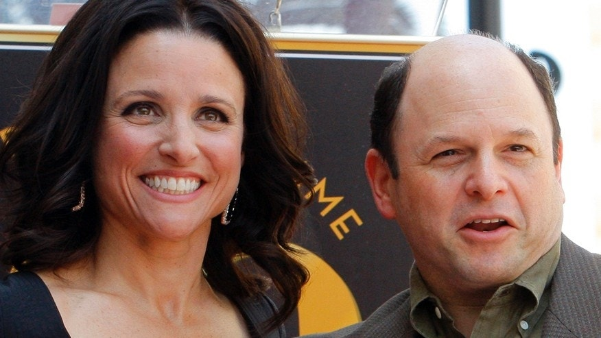 "Actress Julia Louis-Dreyfus (L) poses with ""Seinfeld"" co-star Jason Alexander at a ceremony to unveil her star on the Hollywood Walk of Fame in Hollywood, California May 4, 2010.   REUTERS/Fred Prouser   (UNITED STATES - Tags: ENTERTAINMENT) - RTR2DGQI"
