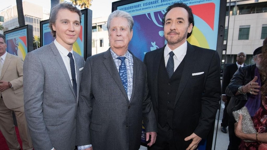 "Paul Dano, from left, Brian Wilson and John Cusack arrive at the LA Premiere Of ""Love & Mercy"" at the Samuel Goldwyn Theater on Tuesday, June 2, 2015, in Beverly Hills, Calif. (Photo by Rob Latour/Invision/AP)"