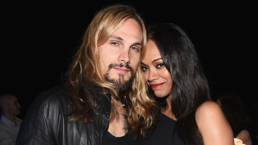 Marco Perego and Zoe Saldana on April 2, 2015 in Los Angeles, California.