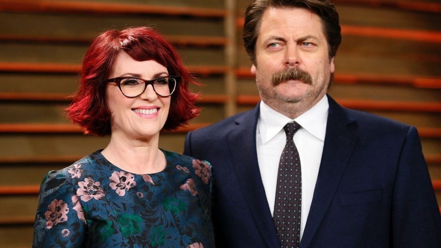 Actress Megan Mullally and actor Nick Offerman arrive at the 2014 Vanity Fair Oscars Party in West Hollywood, California March 2, 2014.