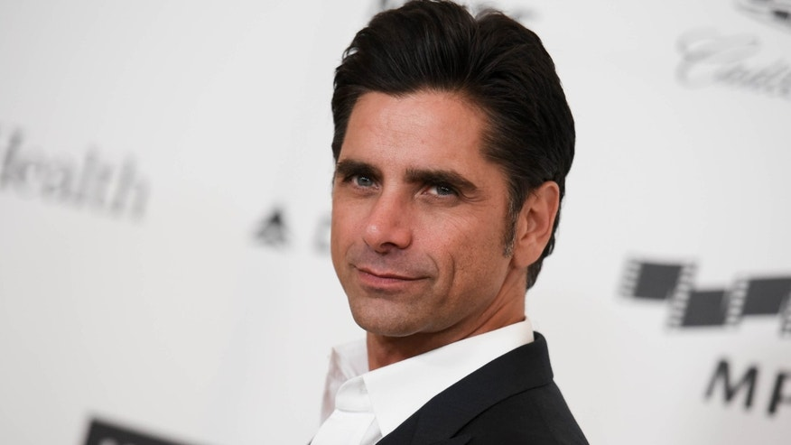 April 25, 2015: John Stamos arriving at the 4th Annual Reel Stories, Real Lives Benefit in Los Angeles.