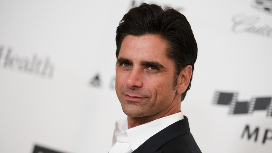 April 25, 2015. John Stamos arriving at the 4th Annual Reel Stories, Real Lives Benefit in Los Angeles.
