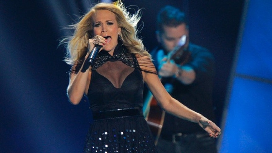 June 10, 2015: Carrie Underwood performs at the CMT Music Awards at Bridgestone Arena in Nashville, Tenn. (Photo by Wade Payne/Invision/AP)