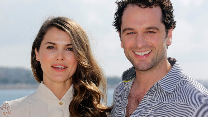 "Actors Kerri Russell (L) and Matthew Rhys pose during a photocall for the television series ""The Americans"" during the annual MIPCOM television programme market in Cannes, southeastern France, October 8, 2012."