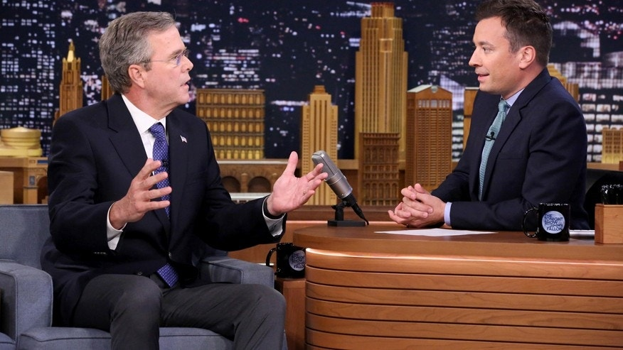 "Former Governor Jeb Bush, left, the new Republican presidential candidate, speaks during an interview with host Jimmy Fallon on ""The Tonight Show Starring Jimmy Fallon,"" Tuesday, June 16, 2015, in New York."