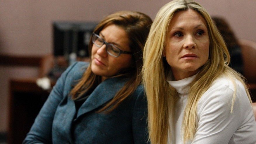 "Nov. 27, 2012. Attorney Ellen Torregrossa-O'Connor, left, holding the hand of former ""Melrose Place"" actress Amy Locane-Bovenizer, 40, of Hopewell Township, N.J. as the jury in her trial returns a verdict in Somerville, N.J."