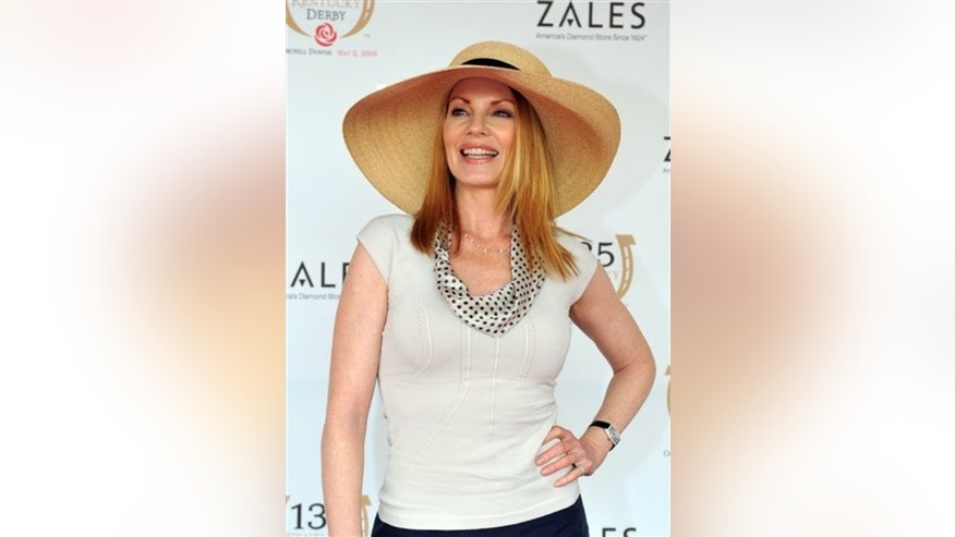 Marg Helgenberger arrives at the 135th Kentucky Derby at Churchill Downs Saturday, May 2, 2009, in Louisville, Ky. (AP Photo/Gail Kamenish)