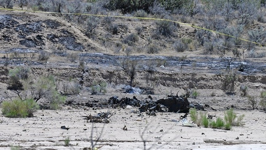 June 22, 2015: Scattered debris remains on the ground following a plane crash near the town of Ventucopa, Calif.