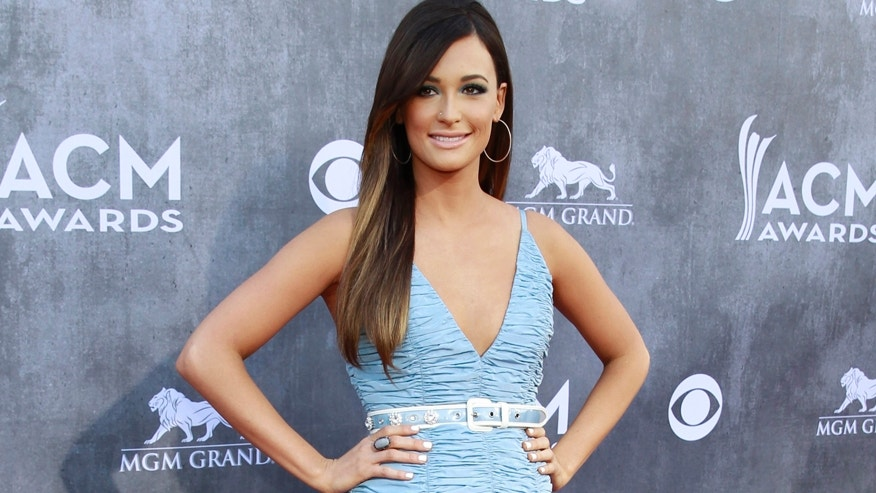 Country music singer Kacey Musgraves arrives at the 49th Annual Academy of Country Music Awards in Las Vegas, Nevada April 6, 2014.