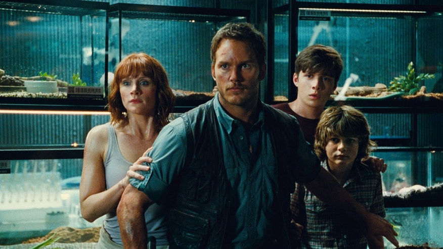 "Bryce Dallas Howard, from left, as Claire, Chris Pratt as Owen, Nick Robinson as Zach, and Ty Simpkins as Gray, in a scene from the film, ""Jurassic World."""
