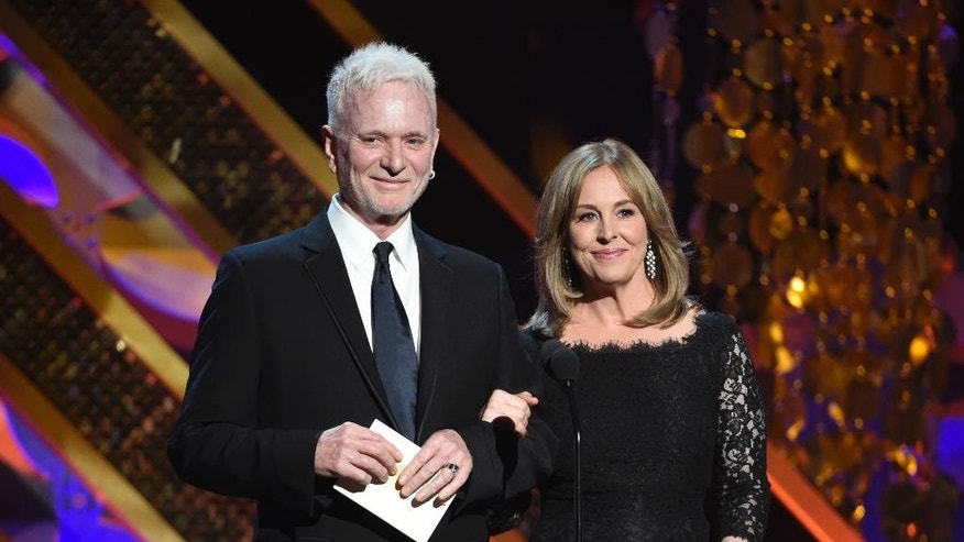 "FILE - In this April 26, 2015, file photo, Anthony Geary, left, and Genie Francis present the award for outstanding drama series at the 42nd annual Daytime Emmy Awards in Burbank, Calif. After 37 years, Geary finishes his role as Luke Spencer on ABC's ""General Hospital,"" on Monday, July 27, 2015. (Photo by Chris Pizzello/Invision/AP, File)"