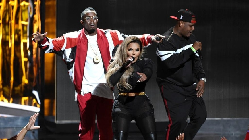 "Sean ""Diddy"" Combs, from left, Lil' Kim, and Sheek Louch perform at the BET Awards at the Microsoft Theater on Sunday, June 28, 2015, in Los Angeles. (Photo by Chris Pizzello/Invision/AP)"