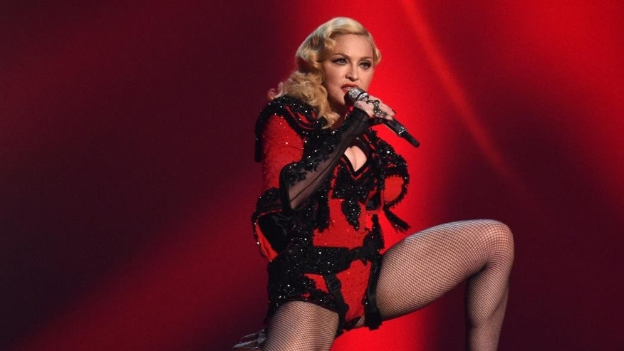 FILE - In this Feb. 8, 2015 file photo, Madonna performs at the 57th annual Grammy Awards in Los Angeles. From Madonna to Mariah Carey, more and more acts are looking to platforms like Tinder and Match to promote their music and reach their fans on-the-go. Madonna worked with Grindr, an app for gay men, to launch a campaign for her latest album, while Jason Derulo looked to Tinder to debut a music video. (Photo by John Shearer/Invision/AP, File)