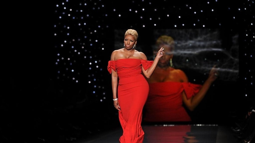 """FILE - In this Feb 6, 2014, file photo, actress and TV personality NeNe Leakes models an outfit from the 2014 Red Dress Collection in New York. Leakes announced Monday, June 29, 2015, she is moving on from """"The Real Housewives of Atlanta."""" The Bravo channel said that Leakes won't return for the reality show's eighth season this fall. (Photo by Brad Barket/Invision/AP, File)"""