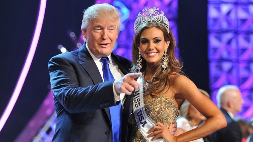 Donald Trump and Miss Connecticut USA Erin Brady after she won the 2013 Miss USA pageant in Las Vegas.