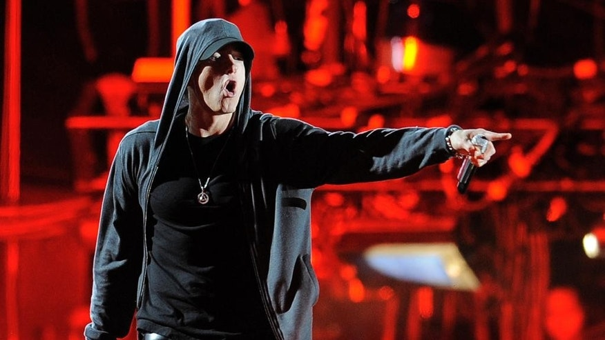 "FILE - In this April 15, 2012, file photo, Eminem performs onstage at the 2012 Coachella Valley Music and Arts Festival in Indio, Calif.   has temporarily taken over a public-access TV show in southeastern Michigan in an episode that featured rapper Eminem. Colbert hosted the latest episode of ""Only in Monroe,"" which airs in the community of about 21,000 people. He talked with Detroit native Eminem in a lengthy segment, calling him by his given name, Marshall Mathers. (AP Photo/Chris Pizzello, File)"