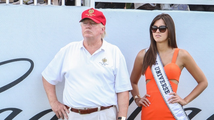 MIAMI, FL - MARCH 05:  Donald Trump and Miss Universe Paulina Vega are seen around Trump National Doral on March 5, 2015 in Miami, Florida.  (Photo by John Parra/Getty Images for Trump Nagtional Doral)