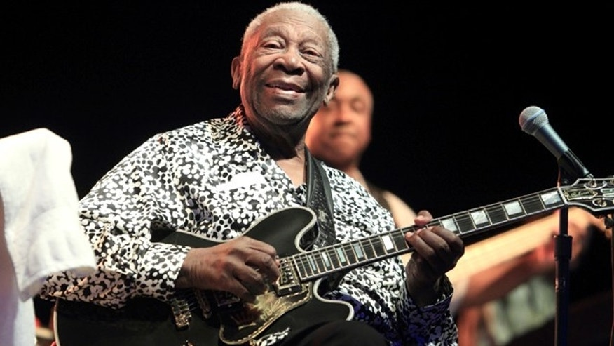 FILE - In this Aug. 8, 2013 file photo, Blues music legend B.B. King performs on Framptons Guitar Circus 2013 Tour at Pier Six Pavilion, in Baltimore. The coroner in Las Vegas says theres no evidence King was poisoned before he died of natural causes in May 2015. (Photo by Owen Sweeney/Invision/AP, File)