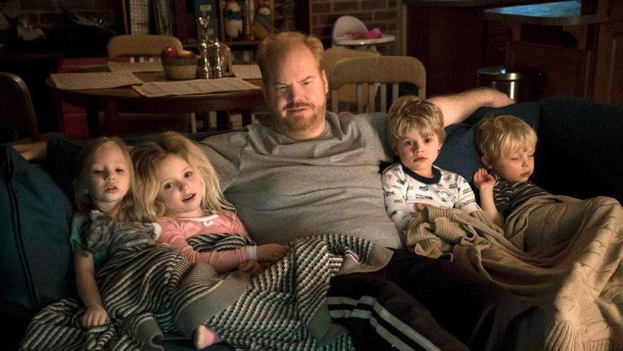 "This image released by TV Land shows Jim Gaffigan, center, in a scene from his new comedy series, ""The Jim Gaffigan Show,"" premiering Wednesday, July 15, at 10 p.m. EDT on TV Land. (TV Land via AP)"
