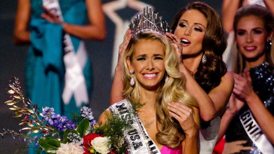 Miss Oklahoma Olivia Jordan is crowned Miss USA by Miss USA 2014 Nia Sanchez during the 2015 Miss USA pageant in Baton Rouge, La., Sunday, July 12, 2015. (AP Photo/Derick E. Hingle)