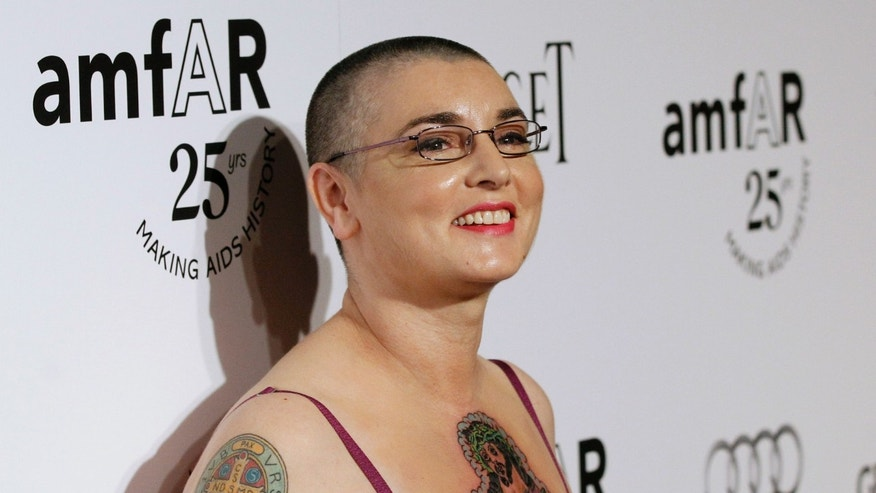 Irish singer and songwriter Sinead O'Connor poses at the amfAR?s Inspiration LA Gala in Hollywood, California October 27, 2011. The gala will benefit the foundation?s AIDS research programs. REUTERS/Mario Anzuoni (UNITED STATES - Tags: ENTERTAINMENT PORTRAIT) - RTR2TB4C