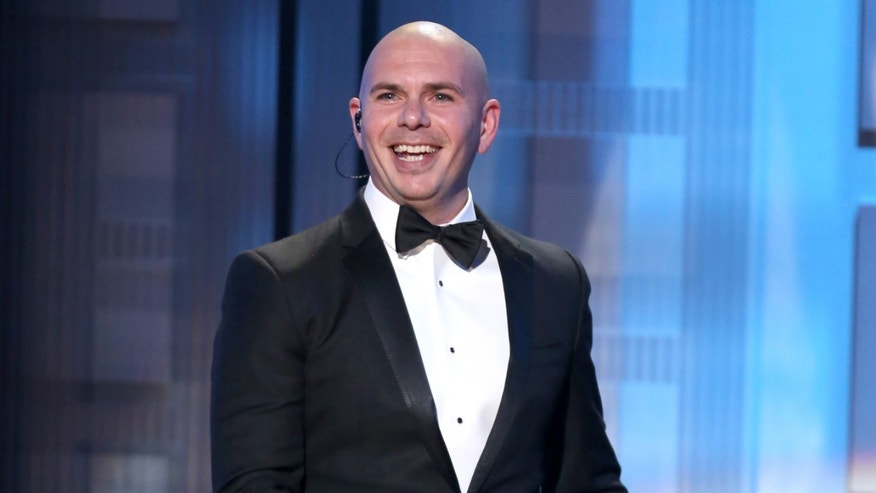 Pitbull hosting the 42nd annual American Music Awards Nov. 23, 2014, in Los Angeles.