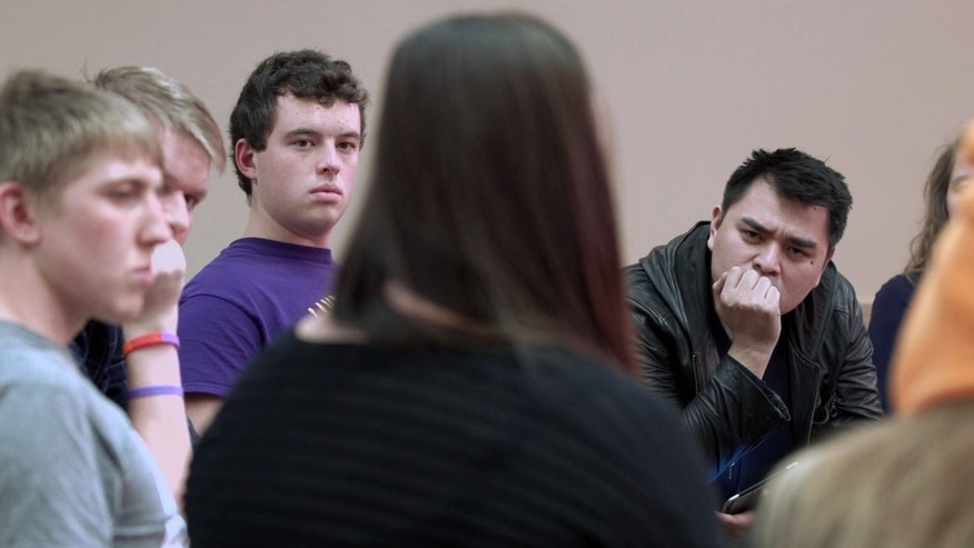 "filmmaker Jose Antonio Vargas listens to a group of young people during the filming of his documentary ""White People."""
