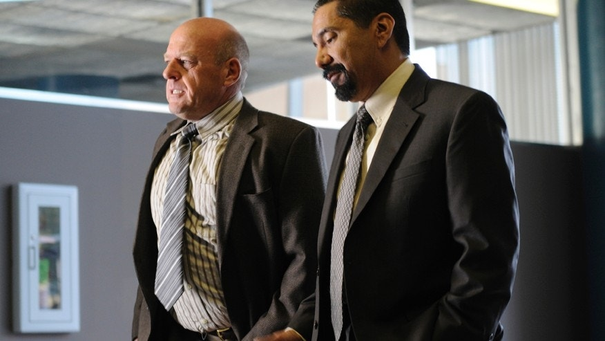 "Hank Schrader (Dean Norris) (left) and Steven Gomez (Steven Michael Quezada) (right) appear in an epsiode of AMC's ""Breaking Bad."""