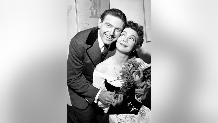 "In this May 12, 1960 file photo, Renee Guerin, of Juneau, Alaska, poses with her costar Theodore Bikel after their performance of ""The Sound of Music"" at the Lunt-Fontanne Theatre in New York City."