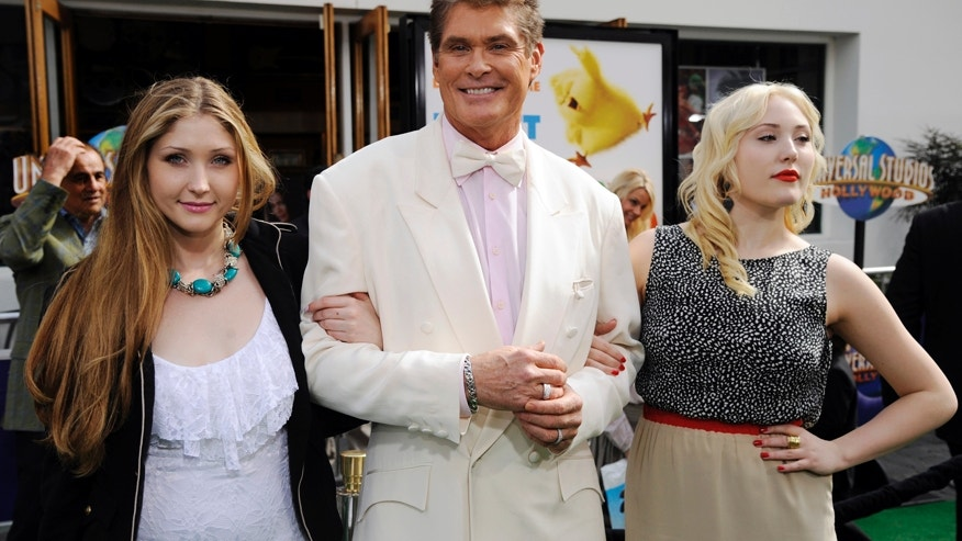 "Cast member David Hasselhoff (C) and daughters Taylor Ann (L) and Hayley Amber (R) attend the premiere of the film ""Hop"" in Los Angeles March 27, 2011."