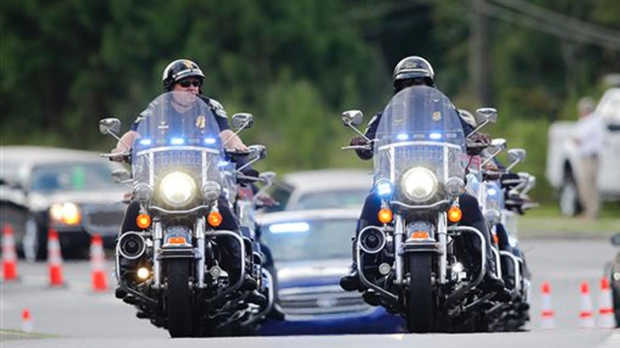 Aug. 1, 2015: Police officers on motorcycles led a procession of mourners to a funeral for Bobbi Kristina Brown in Alpharetta, Ga.