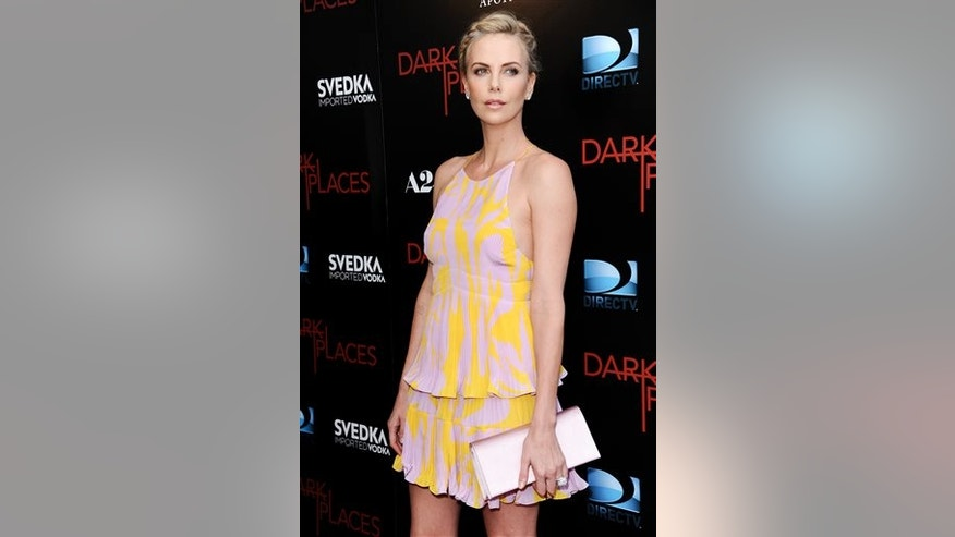 """Charlize Theron arrives at the LA Premiere of """"Dark Places"""" held at Harmony Gold Theater on Tuesday, July 21, 2015, in Los Angeles. (Photo by Richard Shotwell/Invision/AP)"""