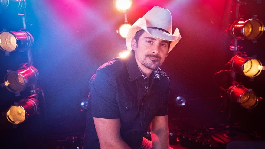 "FILE - In this Aug. 28, 2014 file photo, country musician Brad Paisley poses for a portrait in New York. Paisley is joining ""The Voice"" this season as an adviser to help fellow country singer Blake Shelton. Paisley will help Shelton mentor his contestants on Team Blake in the competition show that begins Sept. 21 on NBC. (Photo by Amy Sussman/Invision/AP, File)"