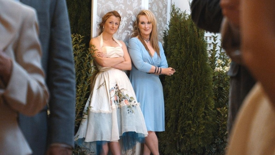"""This photo provided by courtesy of Sony Pictures shows, Mamie Gummer, left, as Julie, and Meryl Streep, as Ricki, in TriStar Pictures' """"Ricki and the Flash."""" The movie opens in U.S. theaters on Aug. 7, 2015.  (Sony Pictures via AP)"""